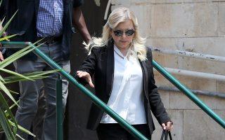 epa07651576 Sara Netanyahu, the wife of Israeli Prime Minister Benjamin Netanyahu, leaves the  Jerusalem's Magistrate Court, Israel, 16 June 2019. Sara Netanyahu attended a hearing on a plea deal over the misuse of state funds for meals at the premier's residence.  EPA/ABIR SULTAN