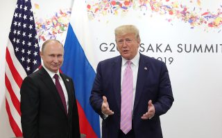 Russia's President Vladimir Putin and U.S. President Donald Trump attend a meeting on the sidelines of the G20 summit in Osaka, Japan June 28, 2019. Sputnik/Mikhail Klimentyev/Kremlin via REUTERS  ATTENTION EDITORS - THIS IMAGE WAS PROVIDED BY A THIRD PARTY.