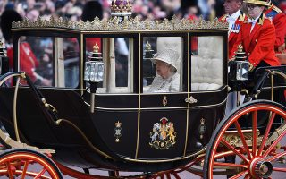 epa07634793 Britain's Queen Elizabeth II rides in a carriage during the Trooping the Colour Queen's birthday parade, in central London, Britain, 08 June 2019. The annual official Queen's birthday parade is more popularly known as Trooping the Colour when the Queen's colour is 'trooped' in front of Her Majesty and all the Royal Colonels.  EPA/NEIL HALL