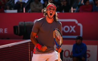 epa07549546 Stefanos Tsitsipas of Greece celebrates during the final match against Pablo Cuevas of Uruguay at the Estoril Open tennis tournament in Cascais, near Lisbon, Portugal, 05 May 2019.  EPA/RODRIGO ANTUNES