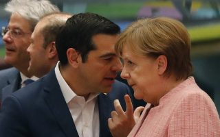 German Chancellor Angela Merkel and Greek Prime Minister Alexis Tsipras attend a European Union leaders summit in Brussels, Belgium, March 22, 2018. REUTERS/Wolfgang Rattay