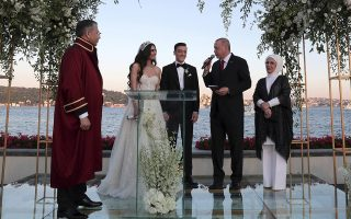 Turkey's President Recep Tayyip Erdogan speaks to Turkish-German soccer star Mesut Ozil and his wife Amine Gulse during a wedding ceremony over the Bosporus in Istanbul, Friday, June 7, 2019.  Erdogan's wife Emine Erdogan is at right and Istanbul Governor and temporary mayor Ali Yerlikaya, left.(Presidential Press Service via AP, Pool)