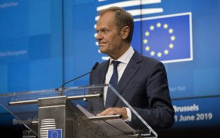 European Council President Donald Tusk speaks during a media conference at an EU summit in Brussels, Friday, June 21, 2019. European Union leaders have failed to back a plan to make the bloc's economy carbon neutral by 2050 in spite of promises to fight harder against climate change. (AP Photo/Virginia Mayo)