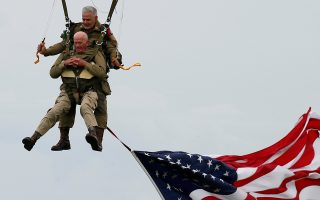 U.S. World War II paratrooper veteran Tom Rice, 97 years-old who served with the 101st Airbone, jumps during a commemorative parachute jump over Carentan on the Normandy coast ahead of the 75th D-Day anniversary, France, June 5, 2019. REUTERS/Pascal Rossignol