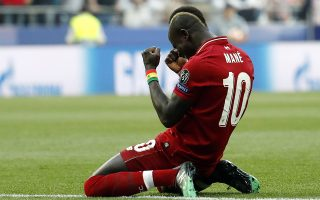 epa07618794 Sadio Mane of Liverpool celebrates after Liverpool have been awarded a penalty during the UEFA Champions League final between Tottenham Hotspur and Liverpool FC at the Wanda Metropolitano stadium in Madrid, Spain, 01 June 2019.  EPA/Emilio Naranjo