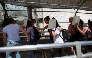 Aides of U.S. Senator Cory Booker (D-NJ) escort migrants seeking asylum towards El Paso, Texas, U.S., as seen at Paso del Norte border crossing bridge in Ciudad Juarez, Mexico July 3, 2019. REUTERS/Jose Luis Gonzalez
