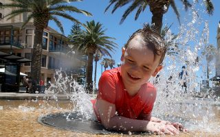 epaselect epa07250203 Five-year-old Kia cools down from the Hot weather at Glenelg beach in Adelaide, South Australia, Australia, 26 December 2018 (issued 27 December 2018). Severe fire danger is forecast east of Adelaide today, as very hot, dry, weather kicks off a three-day heatwave across the state, with the mercury expected to soar to 44 degrees Celsius in the north east and north west pastoral regions.  EPA/KELLY BARNES AUSTRALIA AND NEW ZEALAND OUT