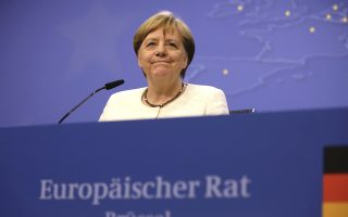 German Chancellor Angela Merkel speaks during a media conference at an EU summit in Brussels, Tuesday, July 2, 2019. After three days of arduous negotiations, European Union leaders broke their top job deadlock Tuesday and nominated German Defense Minister Ursula von der Leyen to become the new president of the bloc's powerful executive arm, the European Commission, taking over from Jean-Claude Juncker for the next five years. (AP Photo/Olivier Matthys)
