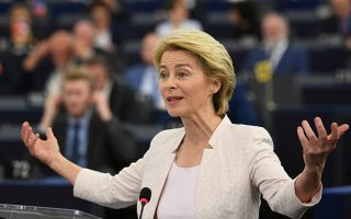 epaselect epa07719767 German Defense Minister Ursula von der Leyen and nominated President of the European Commission delivers her statement at the European Parliament in Strasbourg, France, 16 July 2019.  EPA/PATRICK SEEGER