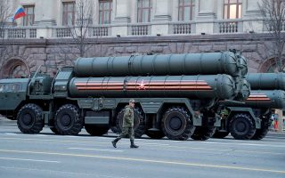 FILE PHOTO: A Russian serviceman walks past S-400 missile air defence systems before a rehearsal for a military parade in Moscow, Russia, April 29, 2019. REUTERS/Tatyana Makeyeva/File Photo