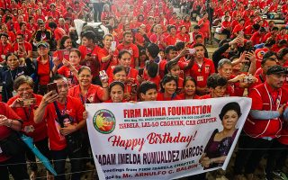 epa07688589 Filipino supporters of former First Lady Imelda Marcos celebrate her 90th birthday, a day ahead of her birthday, in Manila, Philippines, 01 July 2019 (issued 02 July 2019). Famous for her predilection for luxury and her extensive collection of shoes and jewelry, the former First Lady of the Philippines, Imelda Marcos, is turning 90 outside of public life for the first time in almost a decade and cornered by several cases of corruption against her.  EPA/STR