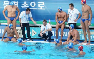 epa07735019 Greece's Head Coach Theodoros Vlachos (3-L) talks to his players during the men's water polo quarter final match between Italy and Greece at the FINA Swimming World Championships 2019 in Gwangju, South Korea. 23 July 2019.  EPA/ANTONIO BAT