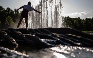 epa07742762 A girl holds her hand into a fountain at Lustgarten park during a hot and sunny weather in Berlin, Germany, 26 July 2019. Germany experiences a heatwave with temperatures up to 41 degrees Celsius.  EPA/CLEMENS BILAN