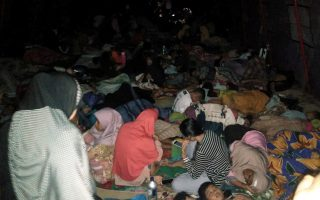 REFILE - CORRECTIG BYLINE   Locals rest outside a mosque as they being sheltered following earthquake hit in South Halmahera, North Maluku, Indonesia, July 14, 2019 in this photo taken by Antara Foto. Picture taken July 14, 2019 Antara Foto via REUTERS   ATTENTION EDITORS - THIS IMAGE WAS PROVIDED BY A THIRD PARTY. MANDATORY CREDIT. INDONESIA OUT.