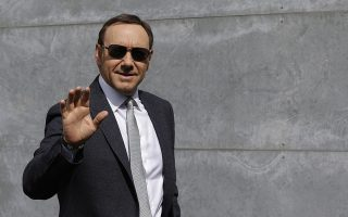 FILE - In this file photo dated Tuesday, June 21, 2016, actor Kevin Spacey waves as he arrives to attend the Giorgio Armani men's Spring-Summer 2016-2017 fashion show in Milan, Italy.  British police have disclosed Wednesday July 4, 2018, that they are now investigating six claims of alleged sexual assault or assault, by Academy Award-winning actor Kevin Spacey, three more than previously disclosed. (AP Photo/Luca Bruno, FILE)
