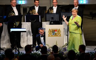 epa07740791 German Chancellor Angela Merkel gestures during the official reception after the opening of the 108th Bayreuth Festival at the Richard-Wagner-Festspielhaus in Bayreuth, Germany, 25 July 2019. The festival opens with the opera 'Tannhaeuser' on 25 July and runs through 28 August.  EPA/PHILIPP GUELLAND