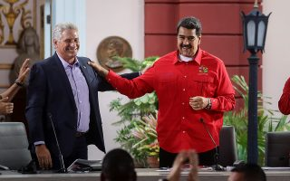epa07746932 Venezuelan President Nicolas Maduro (R) and his Cuban counterpart Miguel Diaz-Canel (L) attend the closure of the XXV Sao Paulo Forum in Caracas, Venezuela, 28 July 2019. The Sao Paulo Forum is a gathering of Latin American and Caribbean left-leaning political parties and organizations.  EPA/RAYNER PENA
