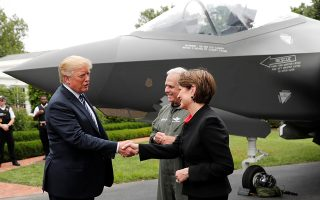 U.S. President Donald Trump greets Lockheed Martin CEO Marillyn Hewson in front of a Lockheed Martin F-35 stealth fighter on the driveway abutting the South Lawn prior to delivering remarks at a showcase of American-made products event at the White House in Washington, U.S., July 23, 2018. REUTERS/Carlos Barria