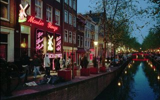 ** FILE ** View of the Oudezijds Achterburgwal in Amsterdam's Red Light district at this May 2, 1996 file photo. The City of Amsterdam said Thursday, Nov. 30, 2006, it is shutting down nearly one-third of the 350 prostitution