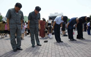 People offer a three-minute silent tribute on the occasion of the 25th anniversary of the death of President Kim Il Sung in Pyongyang, North Korea, Monday, July 8, 2019. (AP Photo/Cha Song Ho)