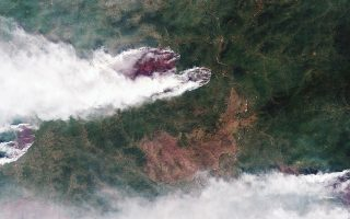 This satellite image provided by Roscosmos Space Agency, taken on Sunday, July 21, 2019, shows forest fires in Krasnoyarsk region, Eastern Siberia, Russia. President Vladimir Putin has ordered Russia's military to join efforts to fight forest fires that have engulfed nearly 30,000 square kilometers of territory in Siberia and the Russian Far East. (Roscosmos Space Agency via AP)