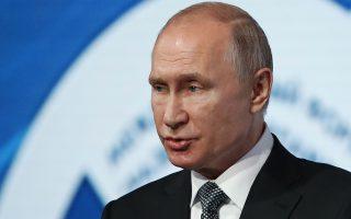 Russian President Vladimir Putin delivers his speech during the International Forum
