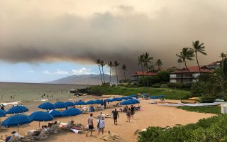 Smoke blankets the sky as a wildfire spreads in Maui, Hawaii, in this July 11, 2019 photo obtained from social media. Roger Norris/via REUTERS THIS IMAGE HAS BEEN SUPPLIED BY A THIRD PARTY. MANDATORY CREDIT. NO RESALES. NO ARCHIVES.