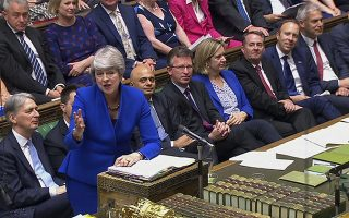 In this grab taken from video, Britain's outgoing Prime Minister Theresa May speaks during her last Prime Minister's Questions in the House of Commons, London, Wednesday July 24, 2019. (House of Commons/PA via AP)