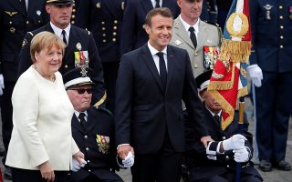 German Chancellor Angela Merkel and French President Emmanuel Macron attend the traditional Bastille Day military parade on the Champs-Elysees Avenue in Paris, France, July 14, 2019. REUTERS/Charles Platiau