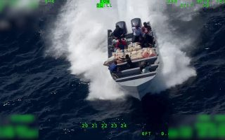 epa07743560 A handout vidoe grab photo made available by the US Coast Guard showing Coast Guard Cutter Steadfast crew members observing suspected drug smugglers throwing items overboard as the vessel is interdicted in international waters of the Eastern Pacific Ocean 18 July, 2019, issued 27 July 2019, during Steadfast's counter-drug patrol in the region. The Coast Guard increased U.S. and allied presence in the Eastern Pacific Ocean and Caribbean Basin, which are known drug transit zones off of Central and South America, as part of its Western Hemisphere Strategy.  EPA/US COAST GUARD / HANDOUT  HANDOUT EDITORIAL USE ONLY/NO SALES