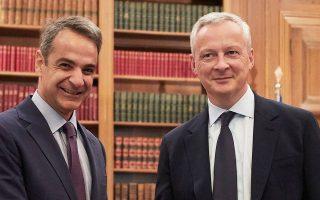 Ο πρωθυπουργός Κ. Μητσοτάκης με τον Γάλλο υπουργό Οικονομικών Μπρινό Λε Μερ.