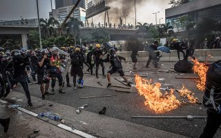 epa07790380 Protesters in action against riot police during an anti-government march in Kwun Tong, Hong Kong, China, 24 August 2019. Hong Kong has been engulfed in protests since early June. The protests have evolved from an anti-extradition bill, now suspended, to a wider to anti-government movement.  EPA/ROMAN PILIPEY