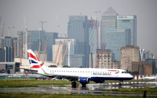 FILE PHOTO: A British Airways airplane taxis at City Airport in London, Britain, September 3, 2018. REUTERS/Hannah McKay/File Photo