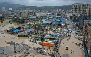 Dajing town is seen damaged and partially submerged in floodwaters in the aftermath of Typhoon Lekima in Leqing, Zhejiang province, China August 10, 2019. Picture taken August 10, 2019. Zhejiang Daily via REUTERS  ATTENTION EDITORS - THIS IMAGE WAS PROVIDED BY A THIRD PARTY. CHINA OUT.