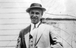 FILE - This is a 1934 file photo of desperado John Dillinger near Moore, Ind. The body of the 1930s gangster is set to be exhumed from an Indianapolis cemetery more than 85 years after he was killed by FBI agents. Two relatives of notorious 1930s gangster John Dillinger who plan to have his remains exhumed say they have