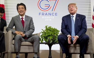 U.S President Donald Trump, accompanied by Japanese Prime Minister Shinzo Abe, left, speaks at a news conference at the G-7 summit in Biarritz, France, Sunday, Aug. 25, 2019, where they announced that the U.S. and Japan have agreed in principle on a new trade agreement. (AP Photo/Andrew Harnik)