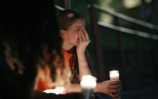 Sherie Gramlich reacts during a vigil for victims of a mass shooting that occurred earlier in the day at a shopping complex Saturday, Aug. 3, 2019, in El Paso, Texas. (AP Photo/John Locher)