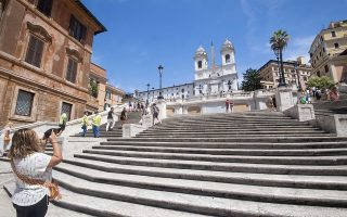 epa07760611 Police officers patrol the Spanish Steps to forbid people to sit on it, in Rome, Italy, 07 August 2019. Sitting on Rome's Spanish Steps is no longer allowed from 06 Augfust 2019 on. The famous steps are also considered to be a monument, meaning sitting or lying on them is banned. Those who breach the ban risk a fine of 250 euros, which can go up to 400 euros if the steps are dirtied or damaged.  EPA/CLAUDIO PERI