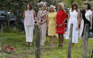 Brigitte Macron, wife of French President Emmanuel Macron, U.S. First Lady Melania Trump, second right, Akie Abe, right, wife of Japan's Prime Minister Shinzo Abe, Chile's First Lady Cecilia Morel, Jenny Morrison, wife of Australia's Prime Minister Scott Morrison, Malgorzata Tusk, third left, wife of European Council President Donald Tusk pose in a field of Espelette pepper in Espelette, near Biarritz, southwestern France, Sunday Aug. 25, 2019. Leaders of major democracies are meeting to discuss the shaky world economy amid trade disputes, rising tensions with Iran and uncertainty over U.S. President Donald Trump's go-it-alone policies. (Regis Duvignau/Pool via AP)