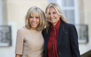 Brigitte Macron, the wife of French President Emmanuel Macron, left, poses for a photo with Mareva Grabowski-Mitsotakis, the wife of Greece's Prime Minister Kyriakos Mitsotakis at the Elysee Palace, Thursday, Aug. 22, 2019 in Paris. (AP Photo/Daniel Cole)