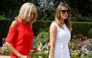 Brigitte Macron, wife of French President Emmanuel Macron, and U.S. First Lady Melania Trump walk in the garden of the Villa Arnaga, House-museum of Edmond Rostand, during a visit on traditional Basque culture in Combo-les-Bains, near Biarritz as part of the G7 summit, France, August 25, 2019.  REUTERS/Regis Duvignau/Pool
