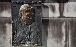 epaselect epa07783228 A plaque featuring Cardinal George Pell is visible at St Mary's Cathedral in Sydney, Australia, 21 August 2019. Cardinal George Pell's appeal has been dismissed by the Court of Appeal and he will remain in prison for sexually abusing two boys in the 1990s.  EPA/JOEL CARRETT  AUSTRALIA AND NEW ZEALAND OUT