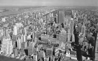 This is a view of the Manhattan borough of New York, looking northwest, as seen from the observation deck of the Empire State Building, Sept. 29, 1938.  At left is the Hudson River, and background center is Central Park.  Between the river and the park is the Upper West Side.  At background left is the George Washington Bridge, crossing over to New Jersey.  (AP Photo/John Rooney)