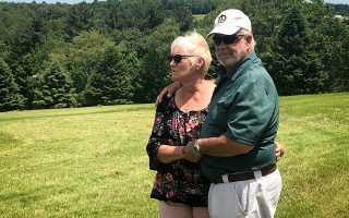 Nick and Bobbi Ercoline, the couple featured on the Woodstock album cover, pose together, at the site where the photo was taken 50 years ago, in Bethel, New York, U.S., June 12, 2019. Picture taken June 12, 2019.  REUTERS/Dan Fastenberg