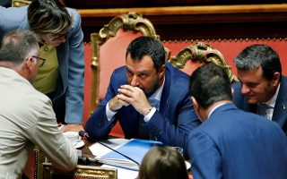 Italy's Interior Minister and Deputy Prime Minister Matteo Salvini listens after the result of the vote on the future of a contested Alpine rail link meant to connect Turin with Lyon, at the Senate, in Rome, Italy, August 7, 2019. REUTERS/Remo Casilli