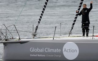 REFILE - QUALITY REPEAT Swedish teenage climate activist Greta Thunberg waves from a yacht as she starts her trans-Atlantic boat trip to New York, in Plymouth, Britain, August 14, 2019. REUTERS/Henry Nicholls