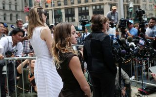 Teala Davies, an alleged victim of Jeffrey Epstein, stands while Gloria Allred, who is representing alleged victims, speaks to the media after a hearing in the criminal case against Epstein, who died this month in what a New York City medical examiner ruled a suicide, at Federal Court in New York, U.S., August 27, 2019. REUTERS/Shannon Stapleton