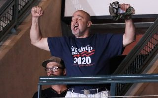 Trump supporter Frank Dawson cheers after helping to eject a small group of protesters during U.S. President Donald Trump?s rally with supporters in Manchester, New Hampshire U.S. August 15, 2019. Dawson later affirmed in a television interview his support for Trump despite Trump apparently mistaking him for a protester and then disparaging his physical appearance. Picture taken August 15, 2019. REUTERS/Jonathan Ernst