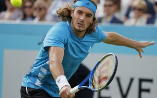 Stefanos Tsitsipas of Greece returns to Jeremy Chardy of France during their singles match at the Queens Club tennis tournament in London, Thursday, June 20, 2019.(AP Photo/Frank Augstein)