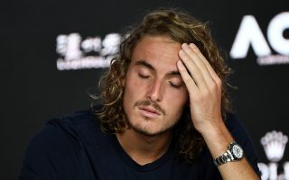 epa07314985 Stefanos Tsitsipas of Greece speaks to the media during a press conference after being defeated by Rafael Nadal of Spain in their men's singles semifinal match at the Australian Open tennis tournament in Melbourne, 24 January 2019.  EPA/JULIAN SMITH AUSTRALIA AND NEW ZEALAND OUT